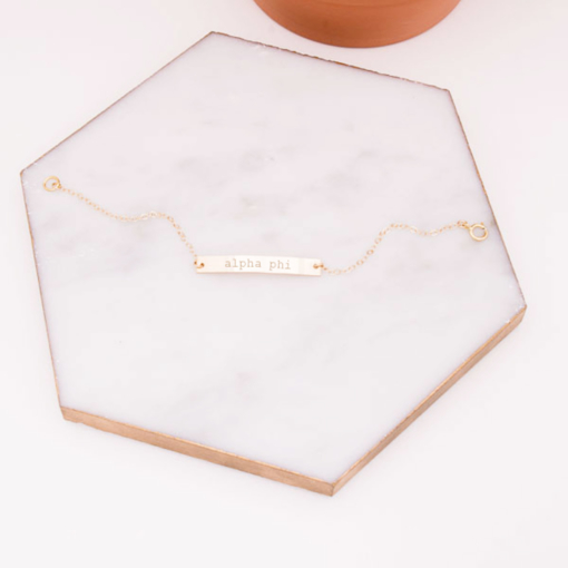 alpha-phi-gold-bar-bracelet-on-marble-engraved