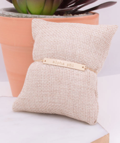 alpha-phi-gold-bar-bracelet-on-pillow-engraved