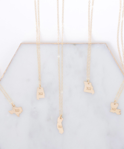 chi-omega-state-necklace-gold-compilation-on-marble