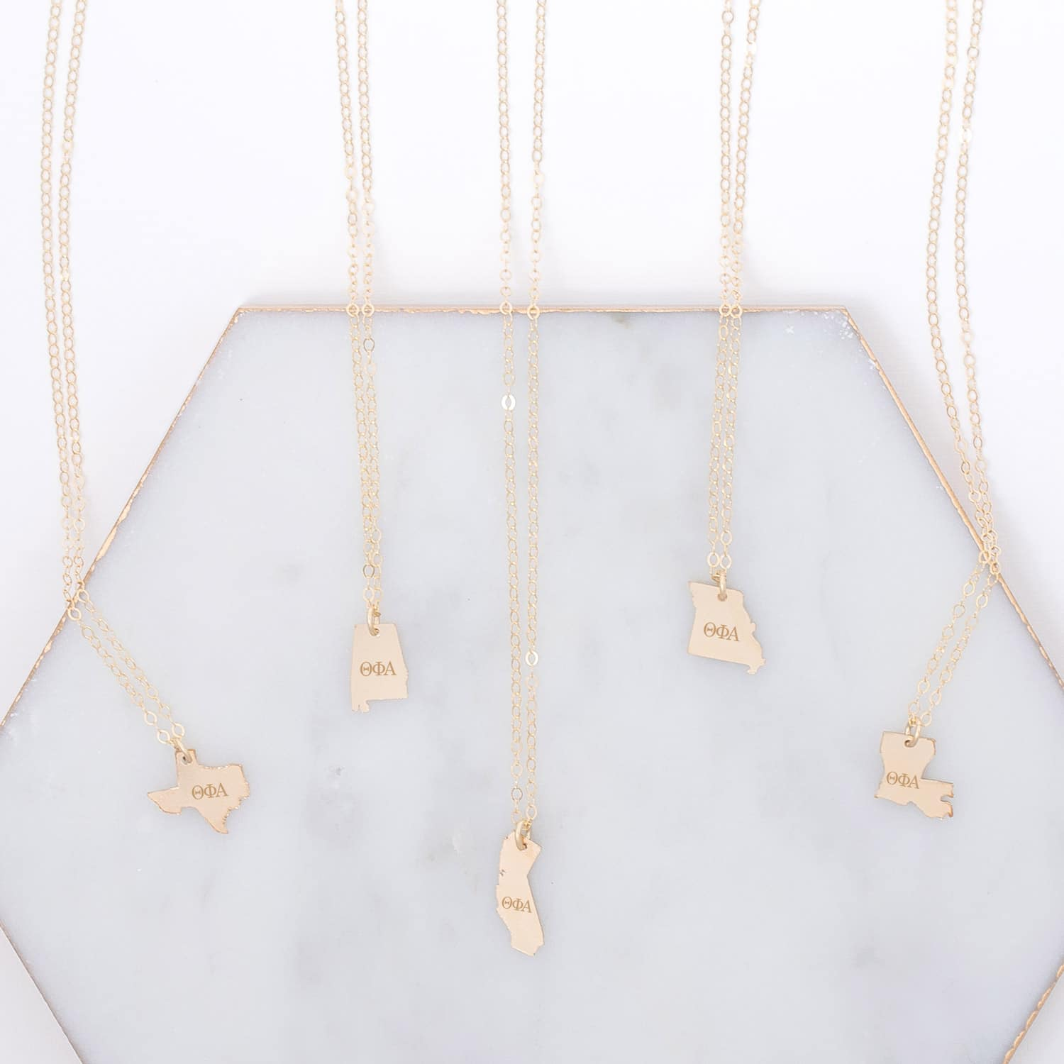 theta-phi-alpha-state-necklace-gold-compilation-on-marble