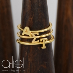 AST-Sorority-Stack-Rings-Gold-on-wood