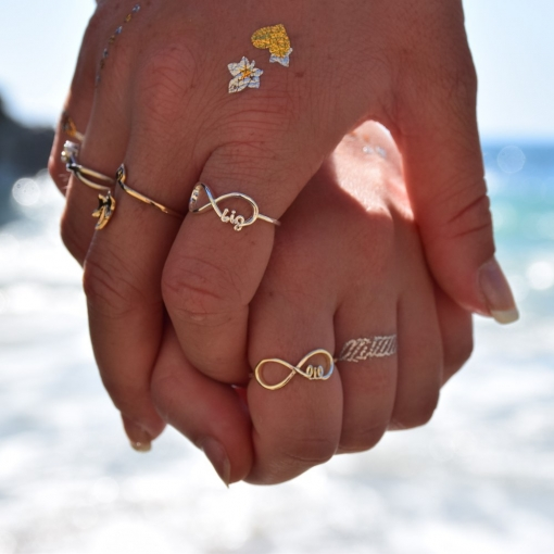 Big-little-sis-infinity-rings-hands-ocean