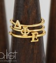 DPhiE-Sorority-Stack-Rings-Gold-on-Wood