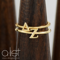 Delta-Zeta-Sorority-Stack-Rings-Gold-on-Wood