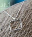 Phi-Mu-Quatrefoil-Necklace-Silver-on-burlap