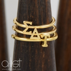 SDT-Sorority-Stack-Rings-Gold-on-Wood