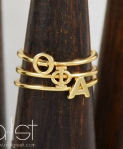 Theta-Phi-Alpha-Sorority-Stack-Rings-Gold-on-Wood