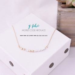 gold-silver-stardust-morse-code-gphi-aka-necklace-decoder