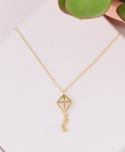 edited-gold-theta-kite-necklace-on-canvas