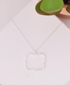 edited-silver-phi-mu-quat-necklace-on-canvas