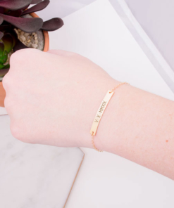 roman-numeral-gold-bar-bracelet-on-wrist-engraved