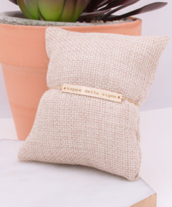kappa-delta-sigma-gold-bar-bracelet-on-pillow-engraved